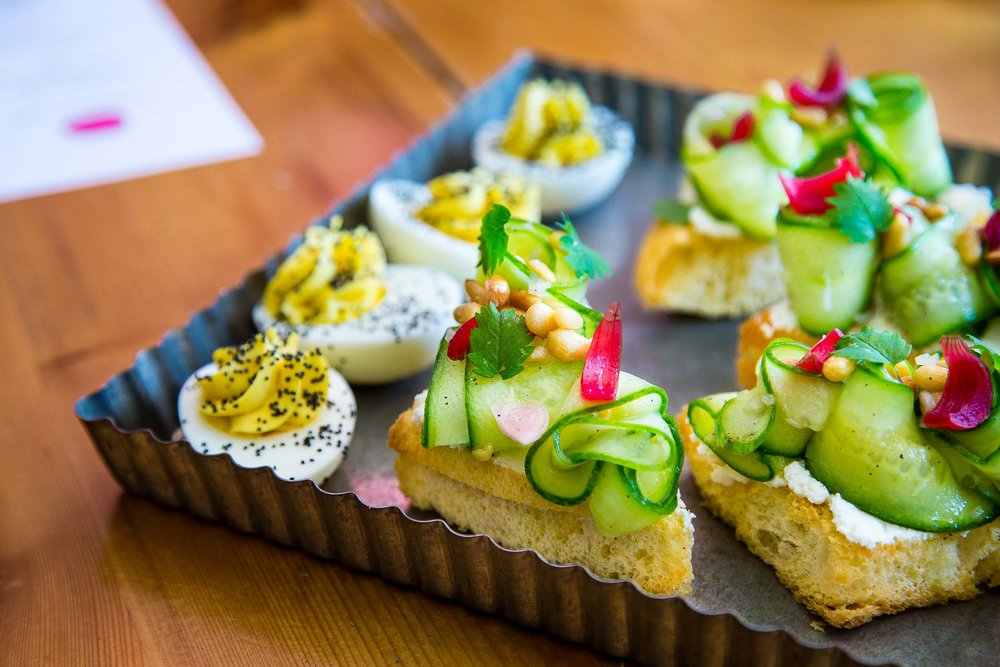 Truffled deviled eggs and tartines with ricotta and cucumber salad