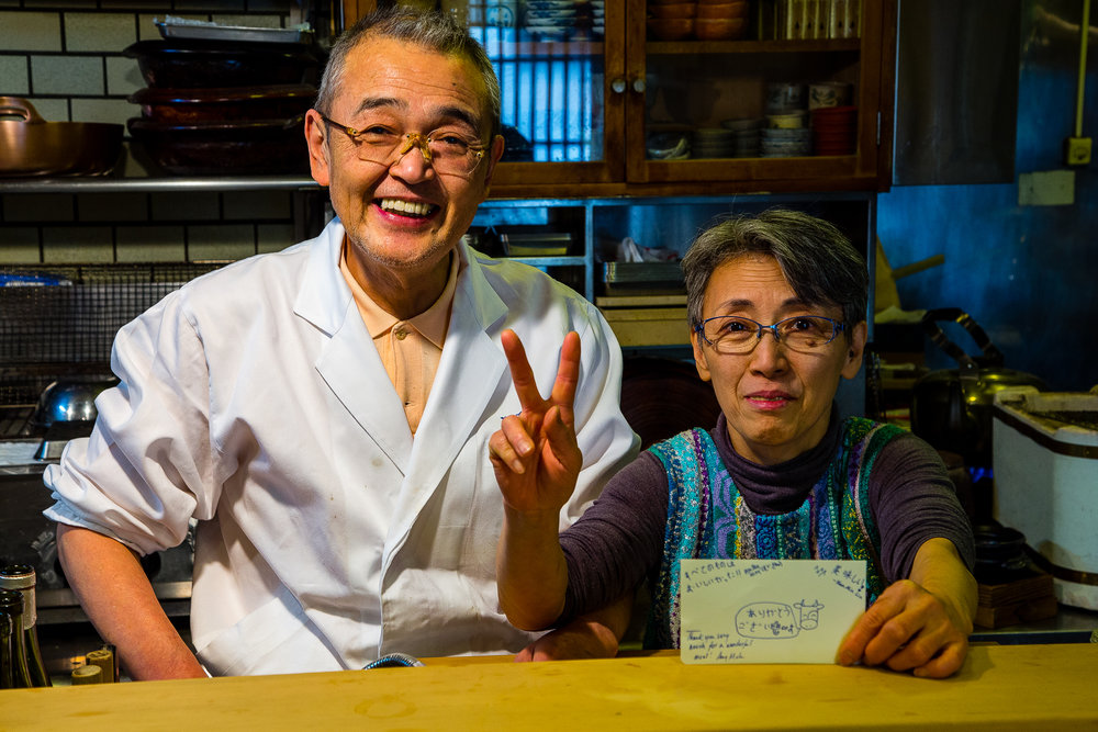 "The owners. Aren't they cute? They also single-handedly run the kitchen. For whatever reason, people love my cow drawings (I can't draw anything else), so I drew them a cow saying, ""ありがとうございもす""."