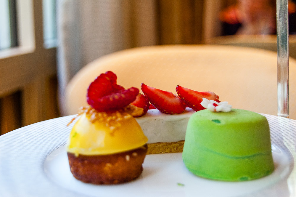 Yuzu pastry, filled with raspberry, and topped with sesame brittle; Strawberry cheesecake; and Green tea chocolate with raspberry and cream inside.