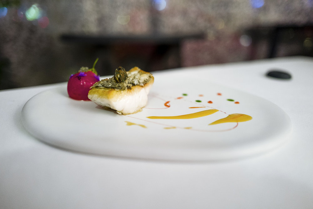Sea Bass, Roasted Edible Scales, Marinated and Confit Tomato, Olive Tapenade, Boulou (?) Vinegar, Bouillabaisse Sauce