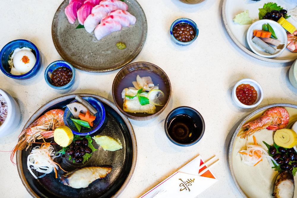 Sashimi: big eye tuna, striped bass, and bright red ikura with yuzu kosho. Red and white represent the Japanese flag.  Ozoni: clam broth with mochi. Stretchy mochi symbolizes longevity.  Multigrain Rice  Poached Egg
