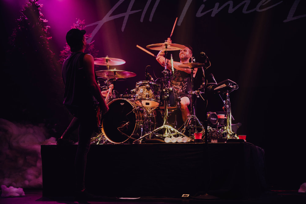 Rian Dawson and Alex Gaskarth of All Time Low at the Eagles Ballroom in Milwaukee, WI on December 22nd   Drummers are always hard to photograph. They usually are the farthest back on the stage which means sometimes the lights never hit them. Whenever I have to leave a show not getting a good photo of the drummer I'm bummed out. Luckily I got this shot at this specific show. Plus even someone that isn't a major All Time Low fan said that this was one of their favourite photos I've ever taken. High compliment!