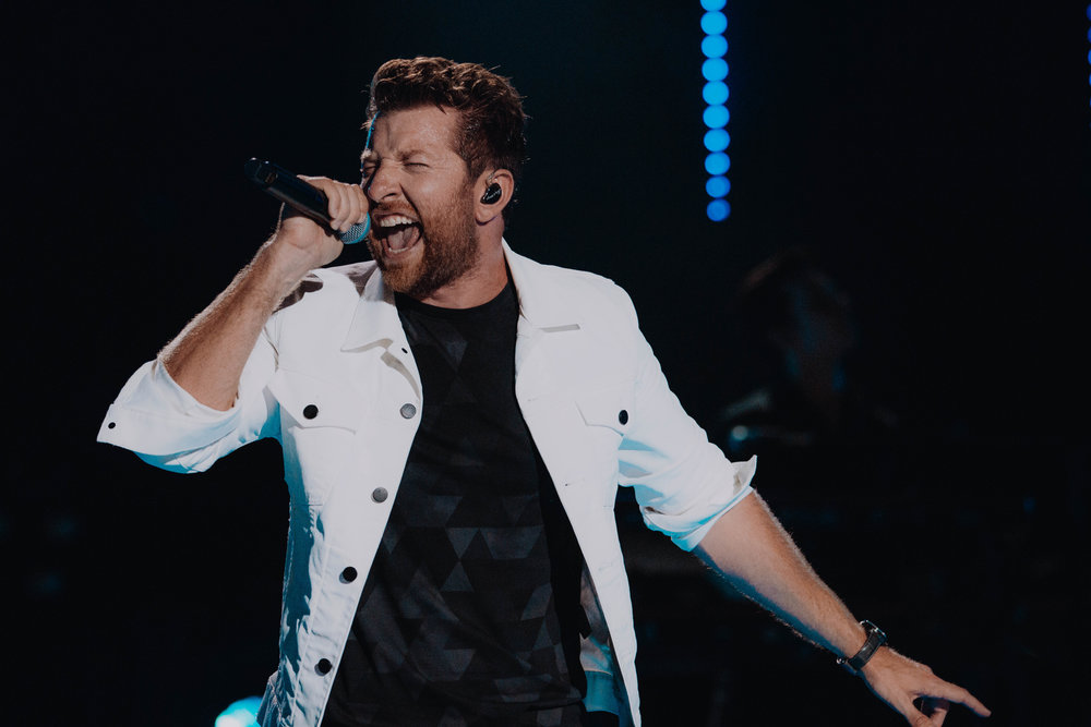Brett Eldredge at Nissan Stadium in Nashville, TN for CMA Fest on June 10th   Brett always brings his A game whenever I've seen him preform live. He always has a ton of energy and I felt like I really captured that with this photo of him. Hopefully you can look at this and hear him hitting the high note he was singing.