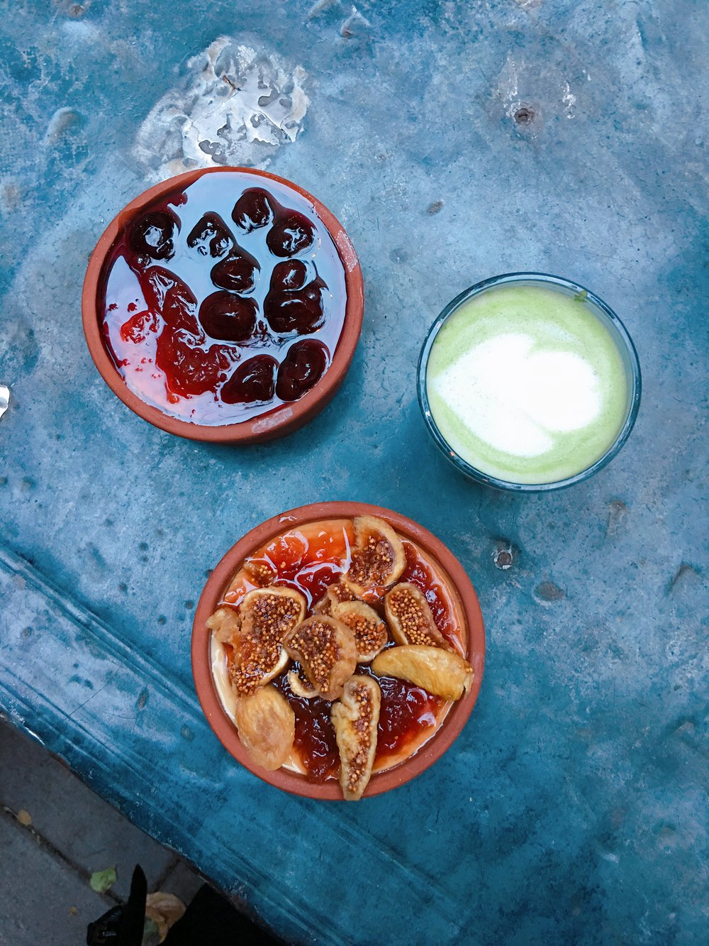 Traditional yogurt with rose petals preserve, dried figs, sour cherries and matcha cortado to fuel your working session!