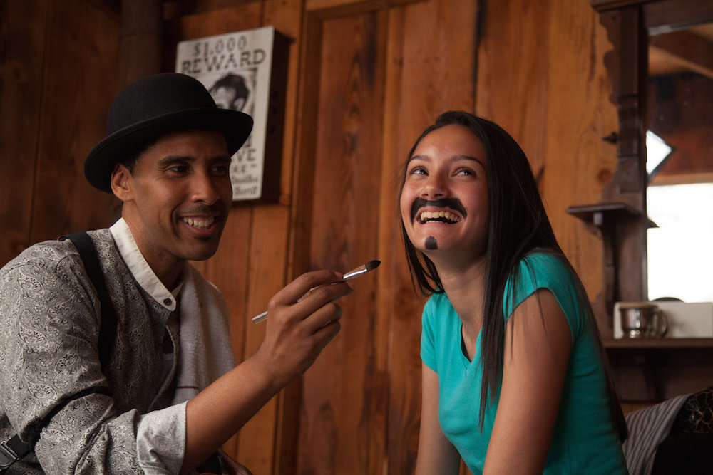 Knott's Ghost Town Alive Barber painting girls mustache.jpg