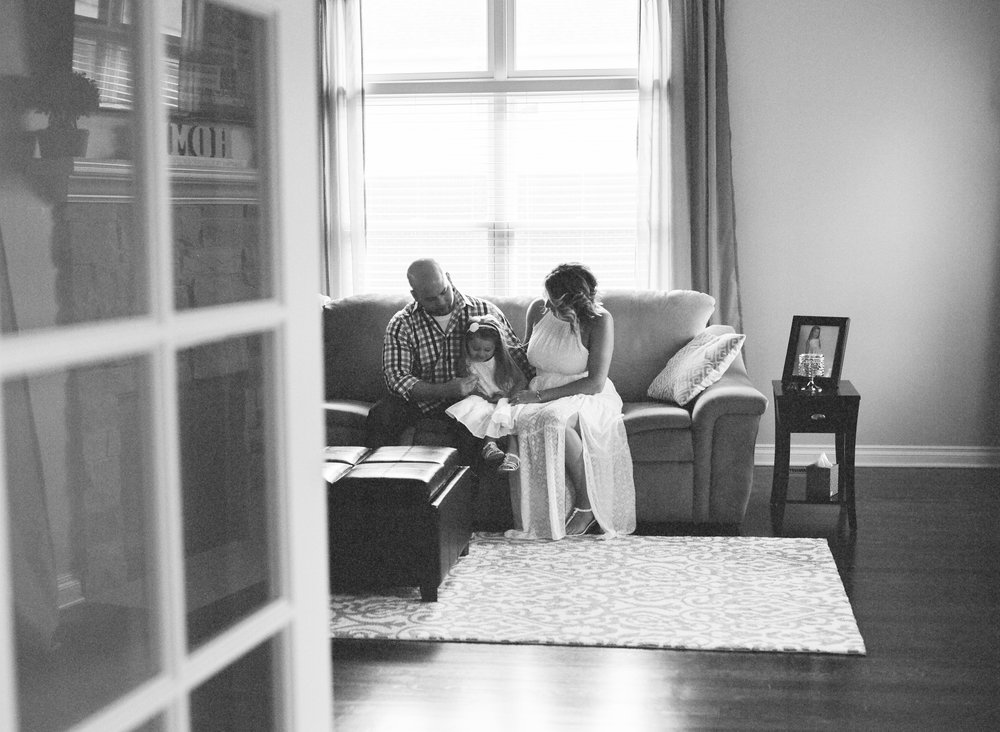 Black and white moody and emotional image of close-knit family during Canton in-home lifestyle family session.Detroit Lifestyle Family Film Photography - Ashley Burnside Photography