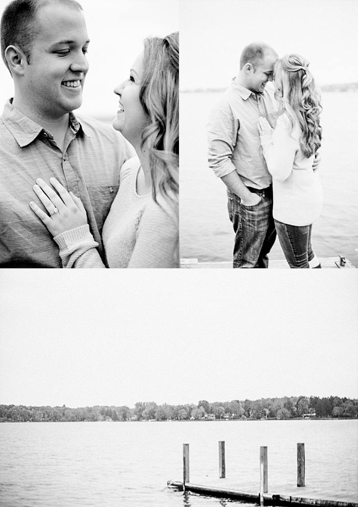 grand rapids engaged couple laugh as they pose for romantic engagement photos by the lake during fall engagement session.