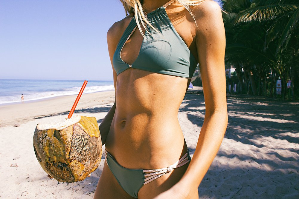 stand out details that make this kini unique are the cut out top and knotted rope bottoms.