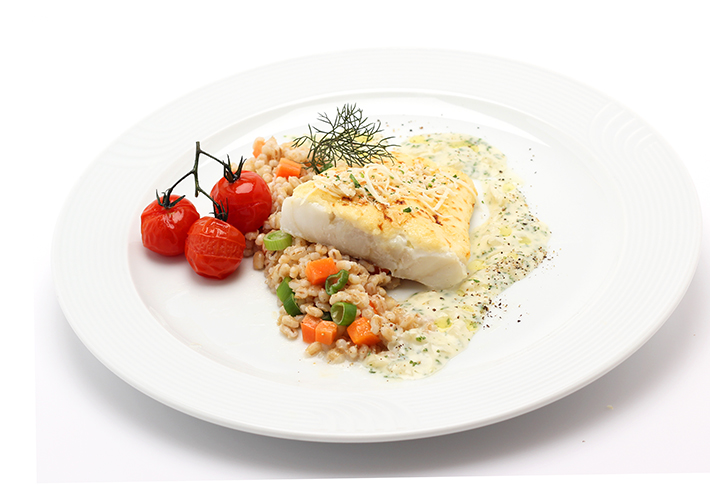 Gratinated Cod Fillet on Tender Wheat and Creamy Herb Sauce