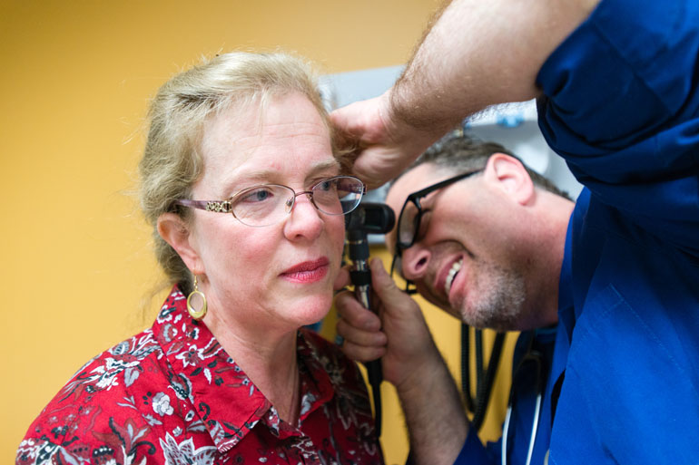 Eileen Bachemin gets her ears checked during her physical exam at the San Fernando Mental Health Center in Granada Hills, Calif., on Monday, February 8, 2016. Bachemin suffers from depression and spent years without health insurance. (Heidi de Marco/KHN)