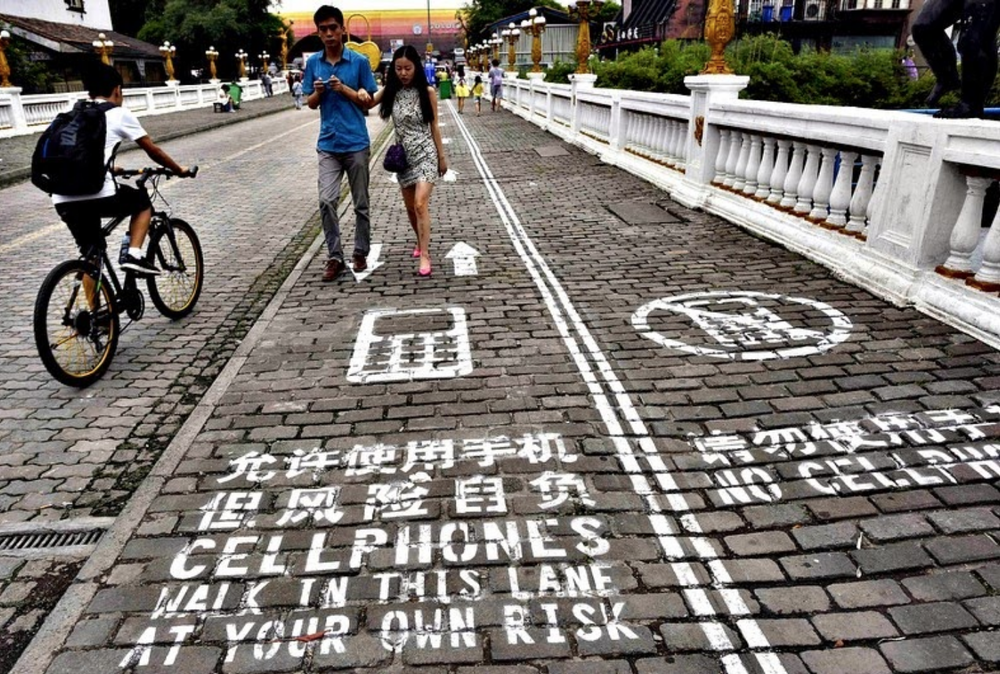 Image of city in China opening sidewalk for mobile phone users.