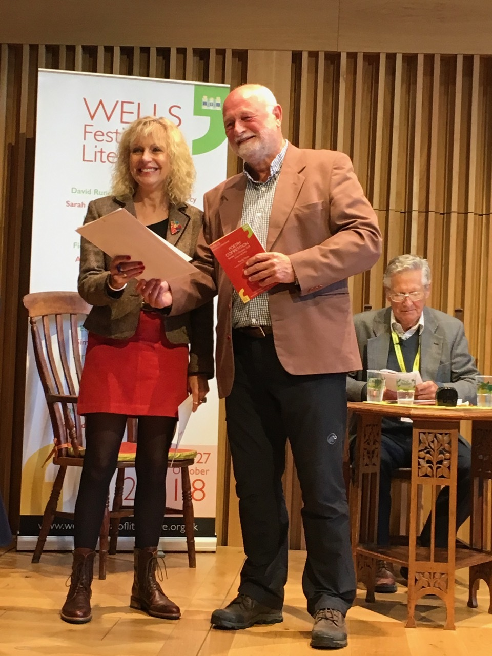 Rosie receiving her prize from Professor Terry Gifford at Wells, October 2018