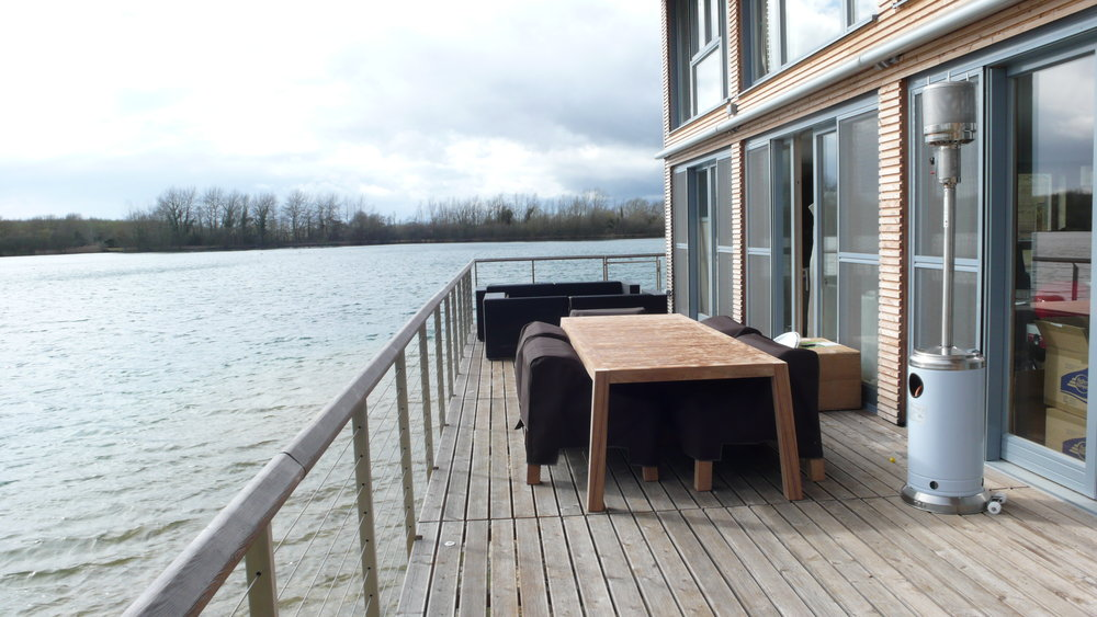 Solid teak outdoor dining table  A durable bespoke design and build to fit existing outdoor teak dining chairs at this lake front holiday home. Commissioned for a private client.