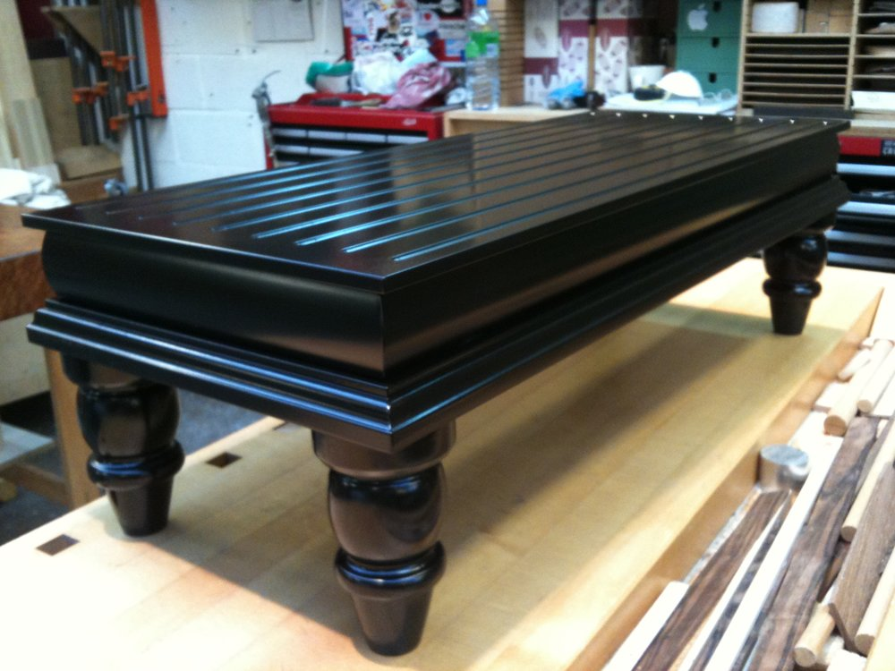 Trad black footstool/coffee table