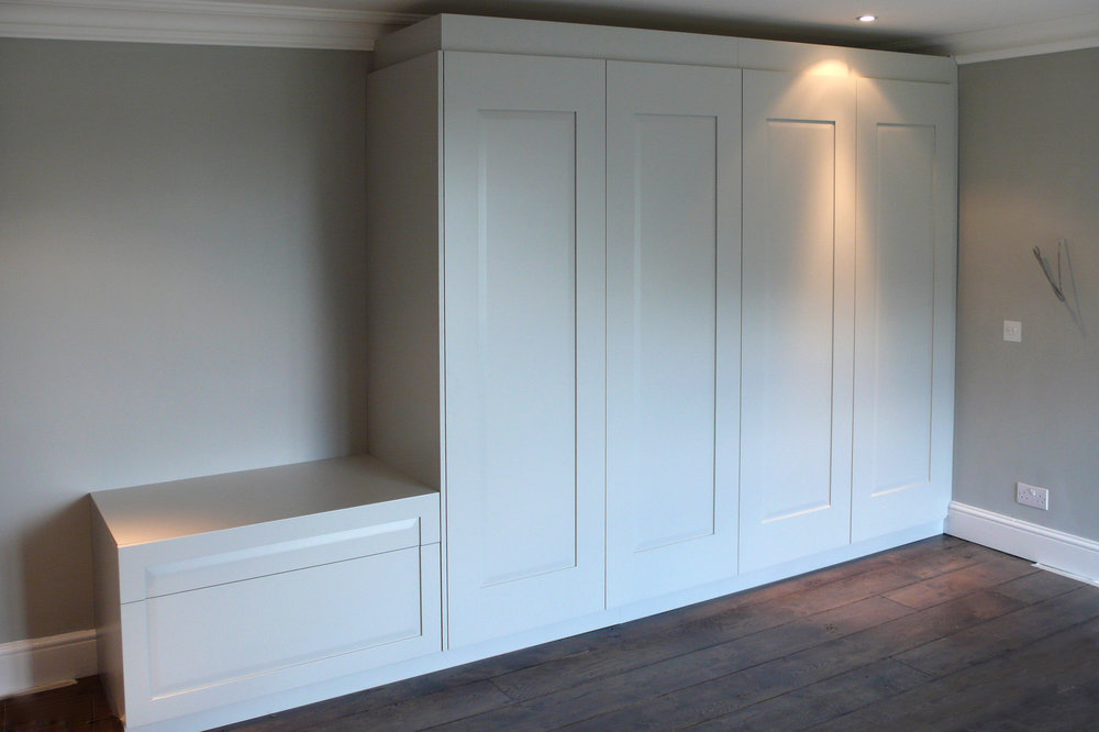 Bespoke frame-and-panel wardrobes and chest