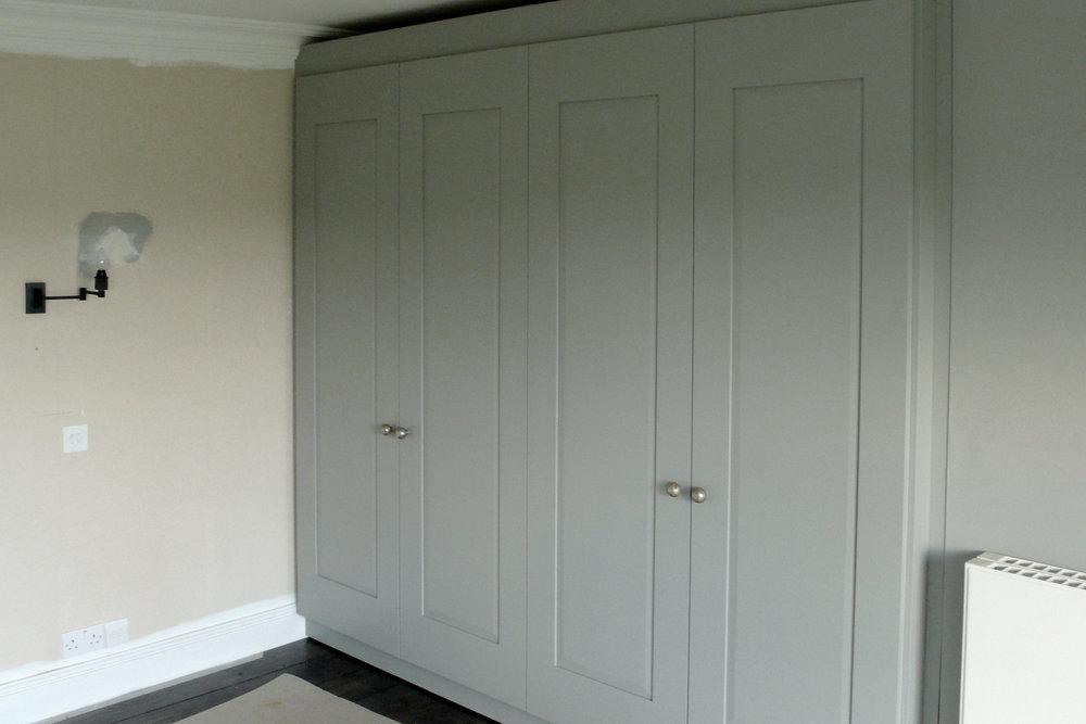 Bespoke frame-and-panel wardrobes