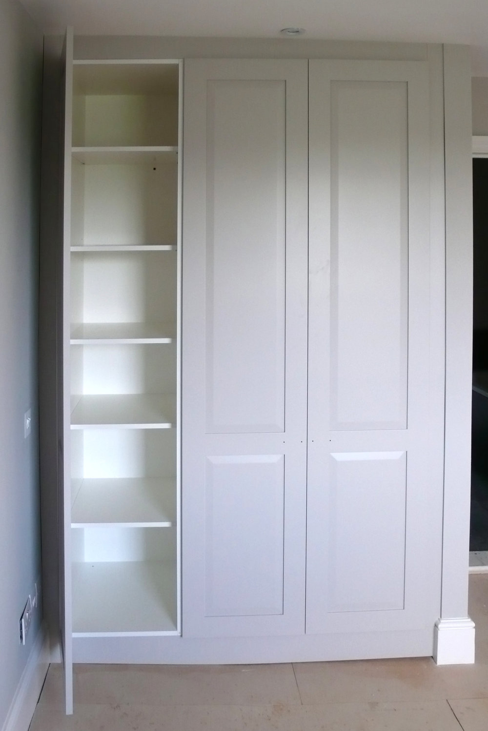 Three door, frame-and-panel cupboard with shelving