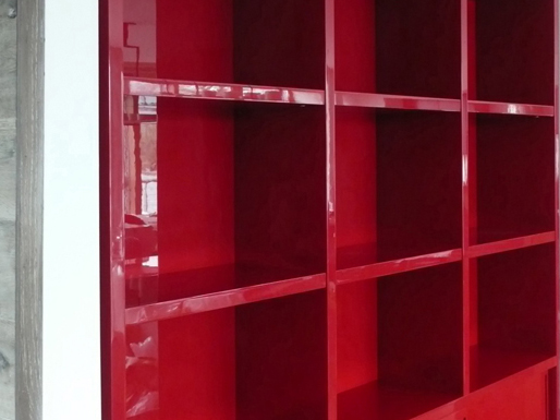 Gloss red built-in bookcases