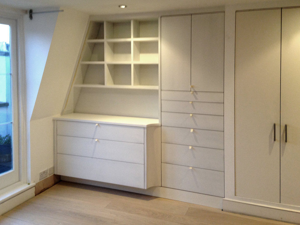 Built-in bedroom cabinetry  Chest of drawers, shelving, drawers, storage and wardrobes, lacquered finish. Commissioned for a private residence.
