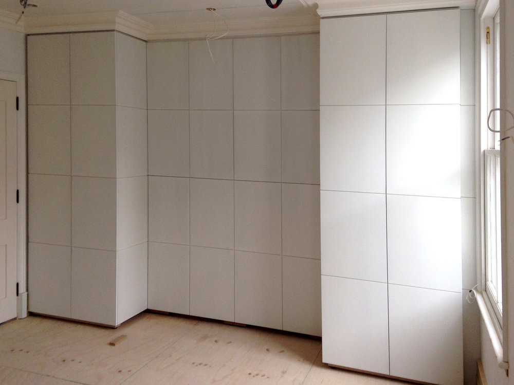 Full height wardrobes with concealed TV cabinet