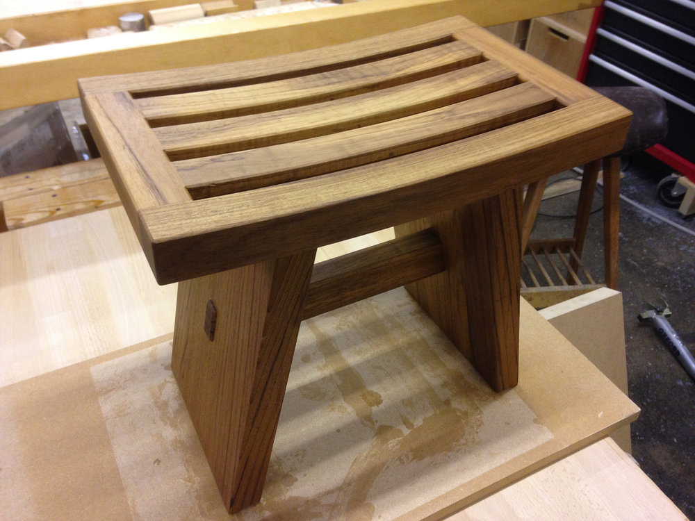 Solid teak Japanese inspired stool for a wet-room