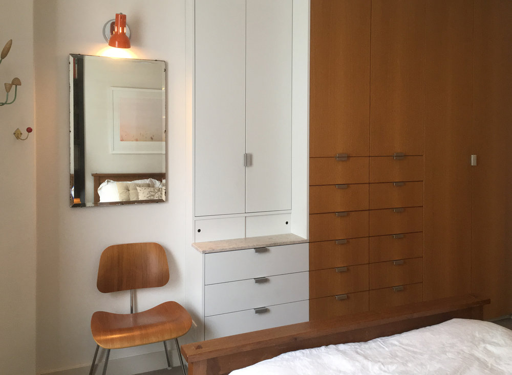 Built-in full-height oak wardrobes with cedar interiors and stone-topped vanity cabinet