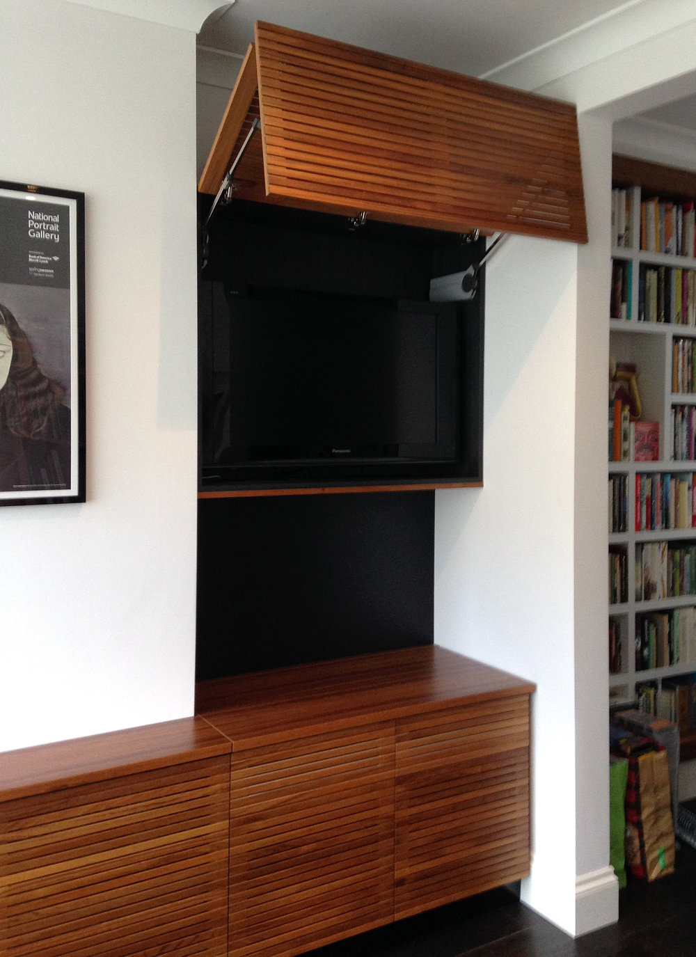 Bespoke buiit-in solid teak TV and turntable console and cabinetry