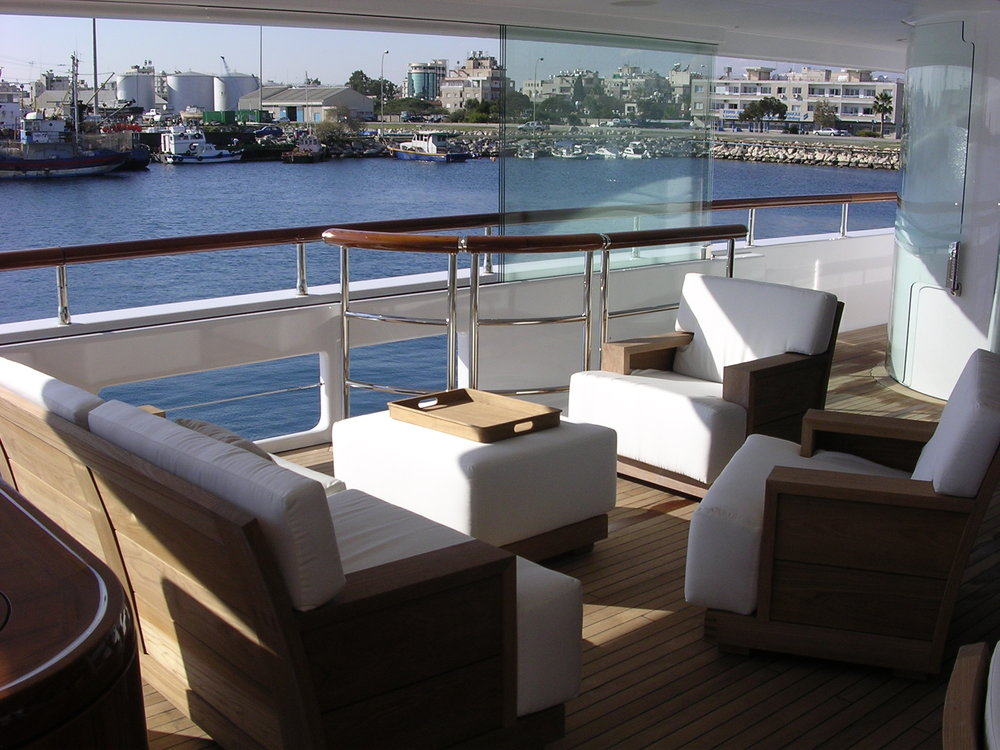 Solid teak yacht deck furniture suite: lounge chairs, sofas, coffee tables, dining chairs and sideboard