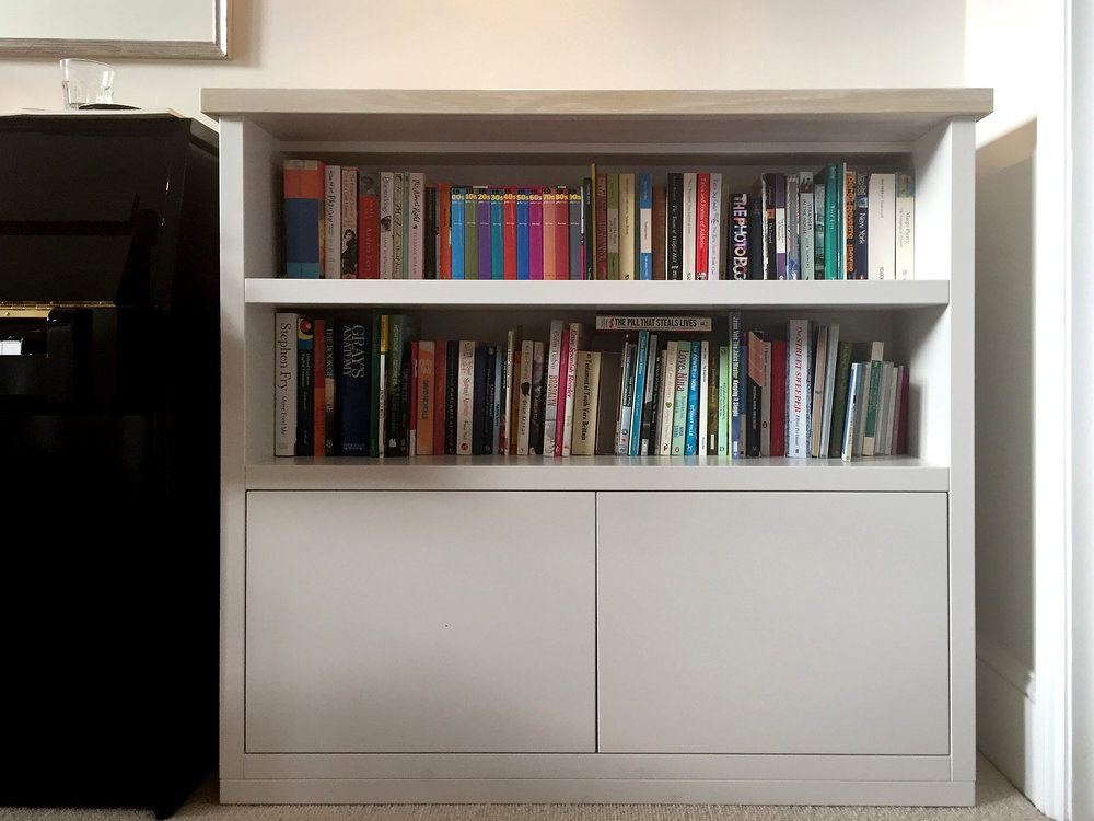 Freestanding bookcase cabinet with white wash oak top