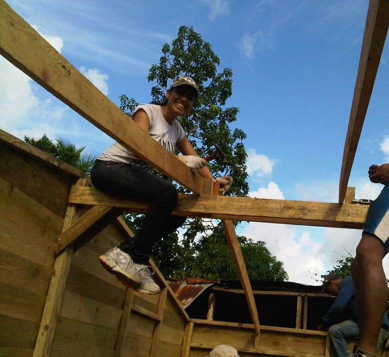 03 - Volunteering at TECHO building houses for families who live in extreme poberty.jpg