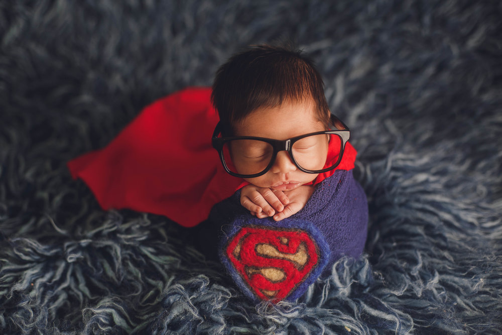 Morristown-newborn-photographer-superman-hero-cape-baby-glasses-clark-kent-potato-sack-blue-red