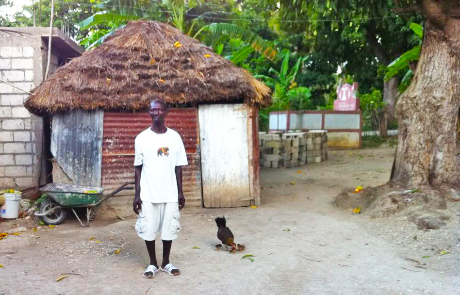 Reynold, our family friend in front of where my grandfathers hut used to be. Mango was tree on the right side.