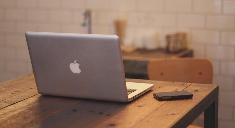 apple-iphone-desk-laptop-large.jpg