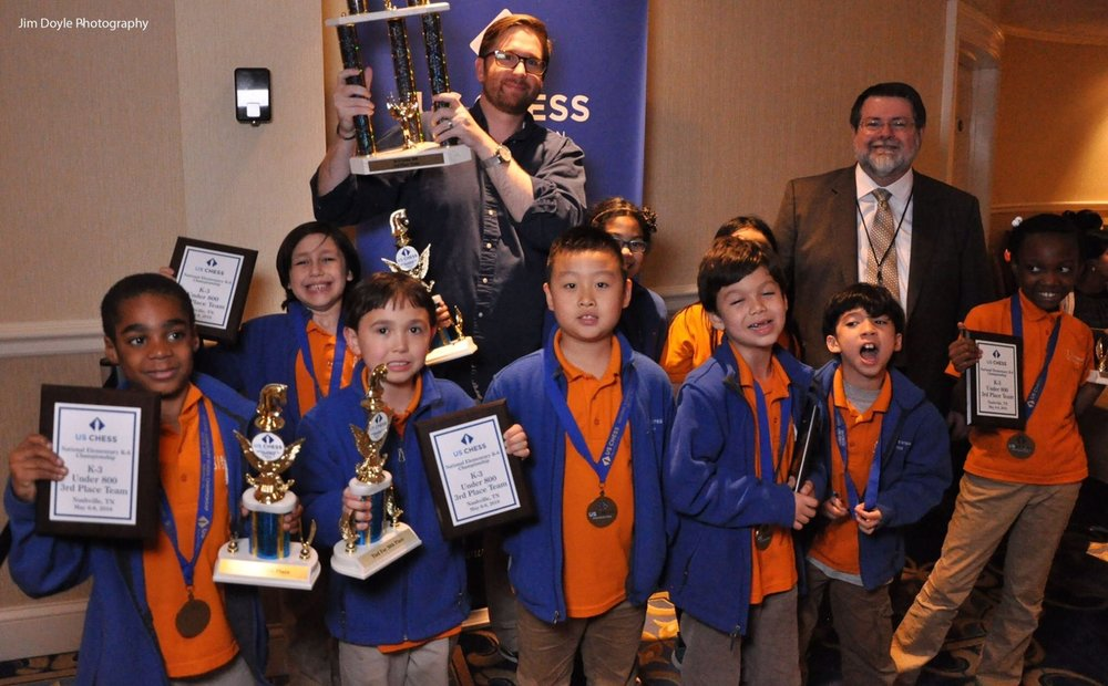 Coach Rob with his 2016 K-3 U800 National Co-Champion team (3rd place based on tiebreaks). It was their first year of competitive chess. Photo by Jim Doyle