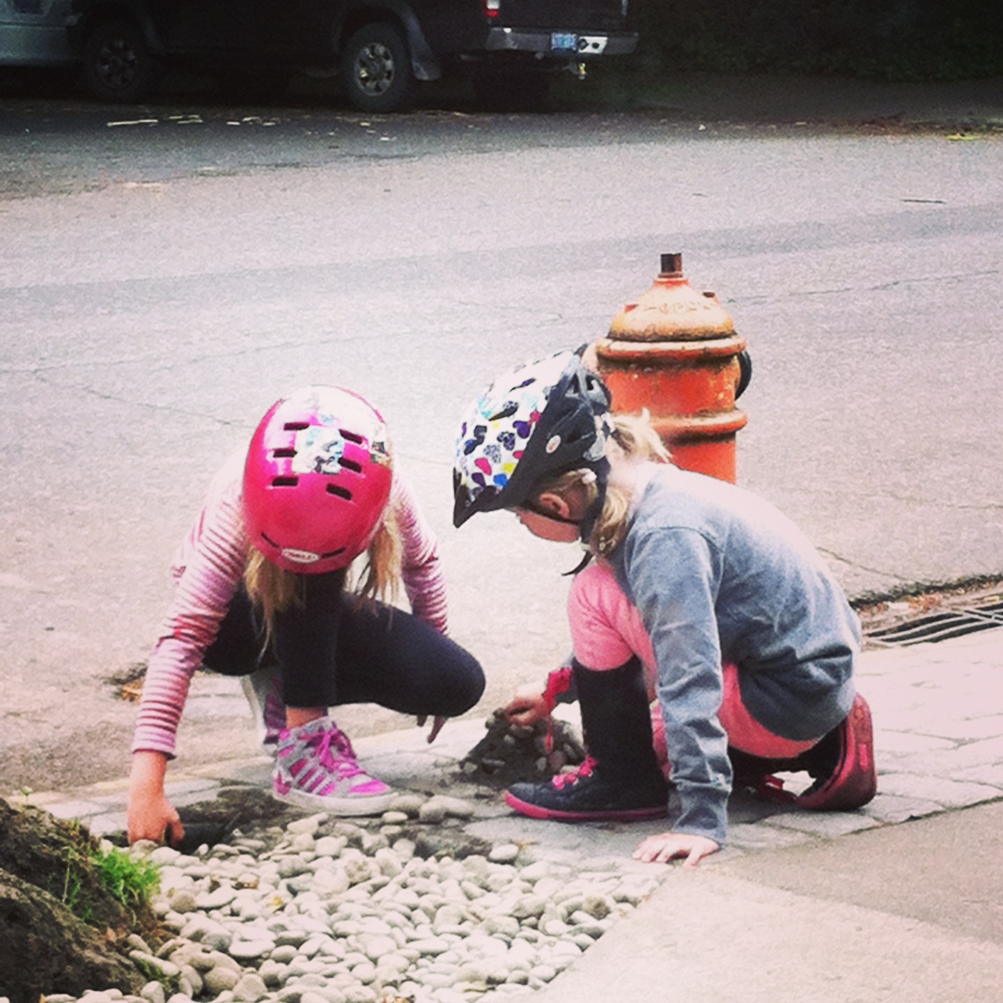 A recent urban observation of mine: two girls passing the time making a dirt mound over a toy horse.