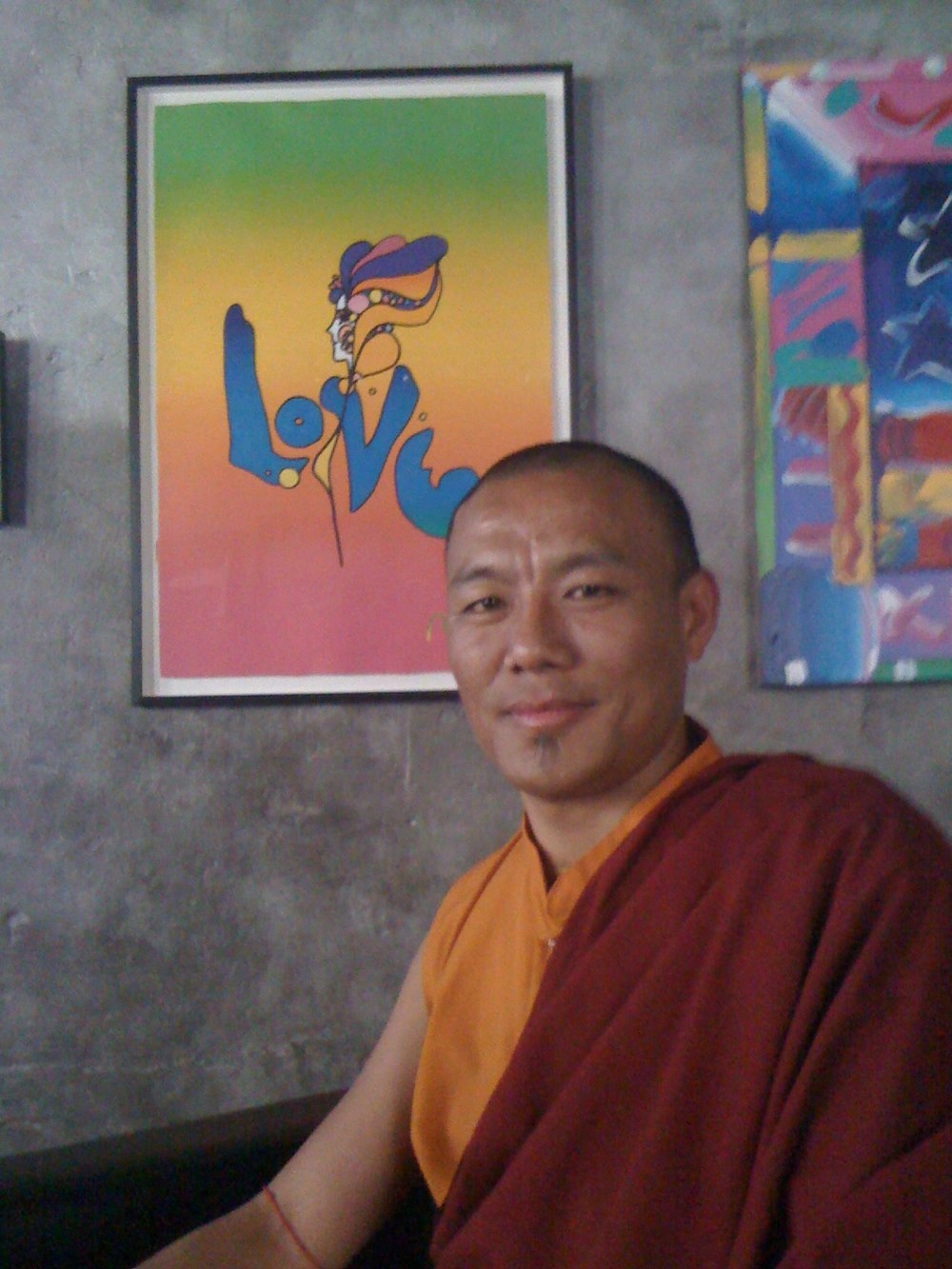 my tibetan monk friend in front of a peter max but only if room.JPG