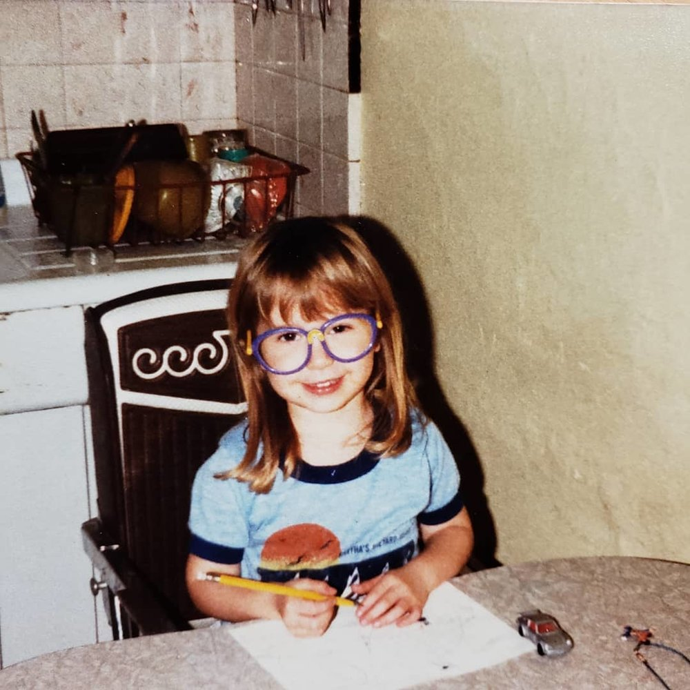 Little Caitlin circa 1984, playing business manager the old school way.