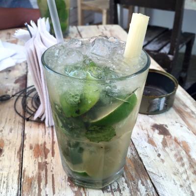 Classic mojito in Tulum with a sugar cane in it