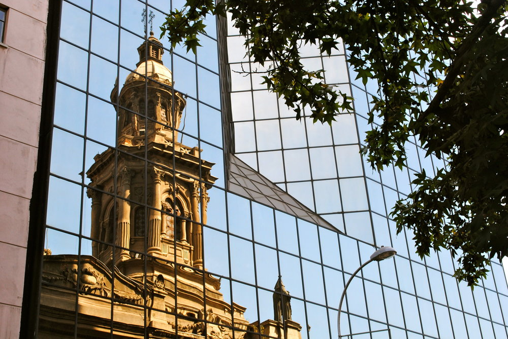 The old reflecting on the new in downtown Santiago.