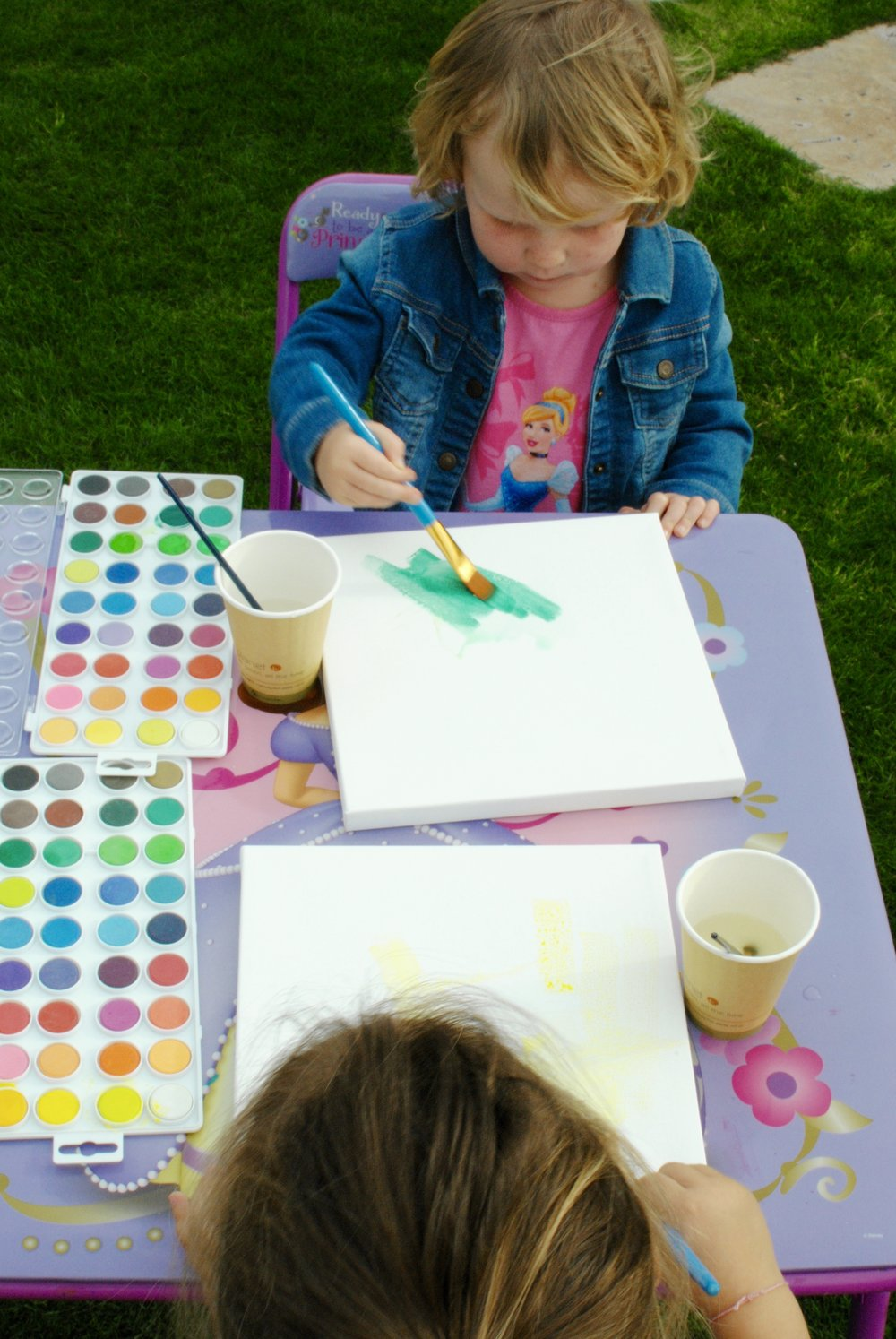 Water painting playdate with American-Chilean cousin, Olive.