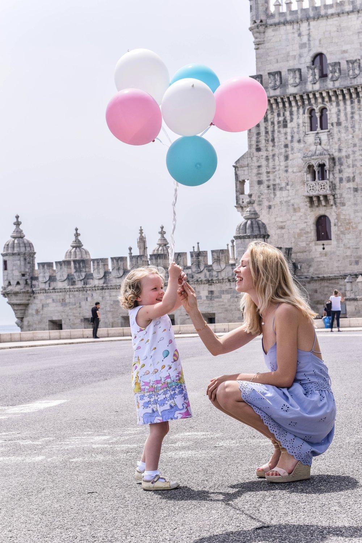 Oh the places she'll go! At the Torre de Belém by  Thayná Moraes Fotografia