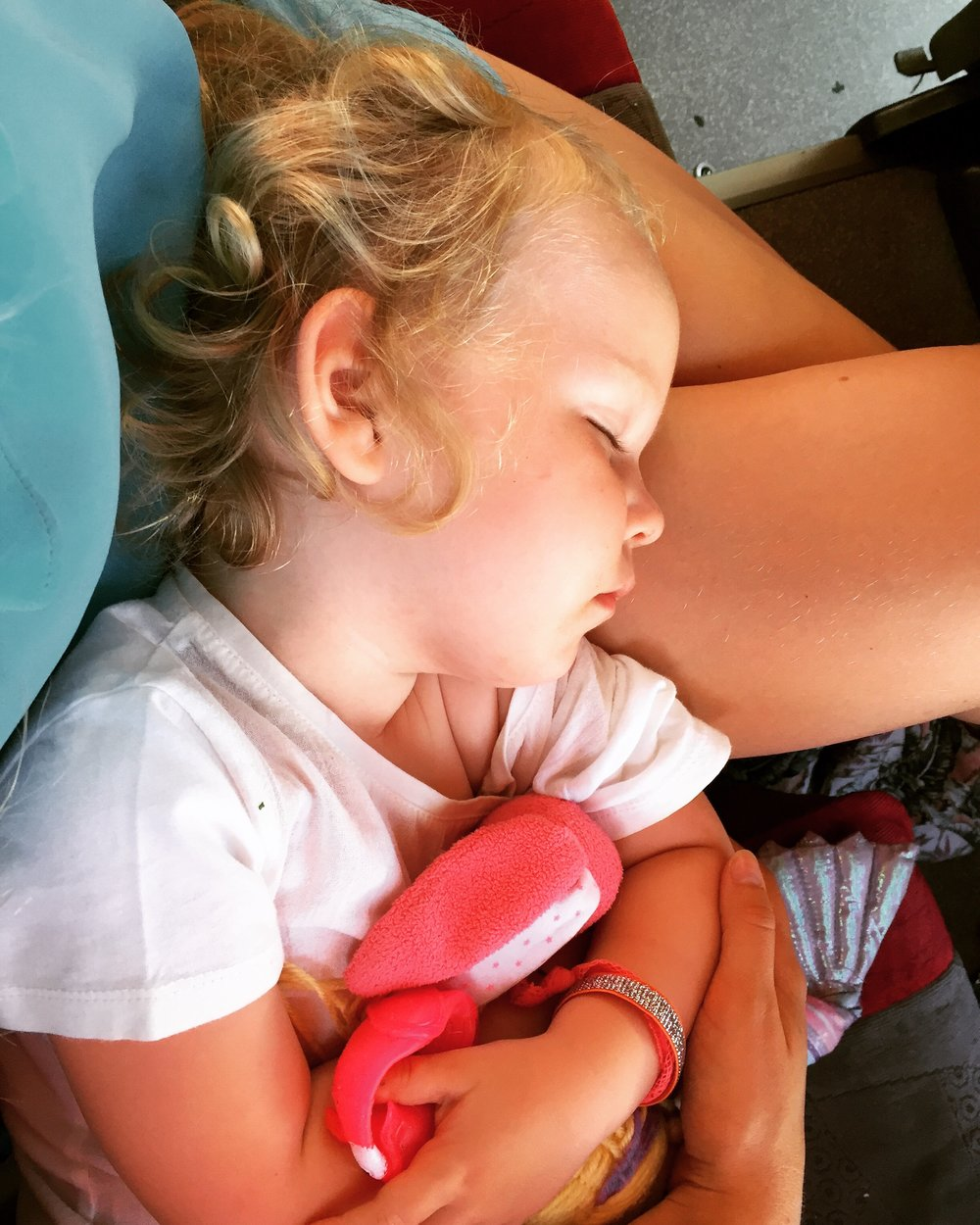 Nap time on our road trip by coach from Malaga to Nerja and Granada,age 2.