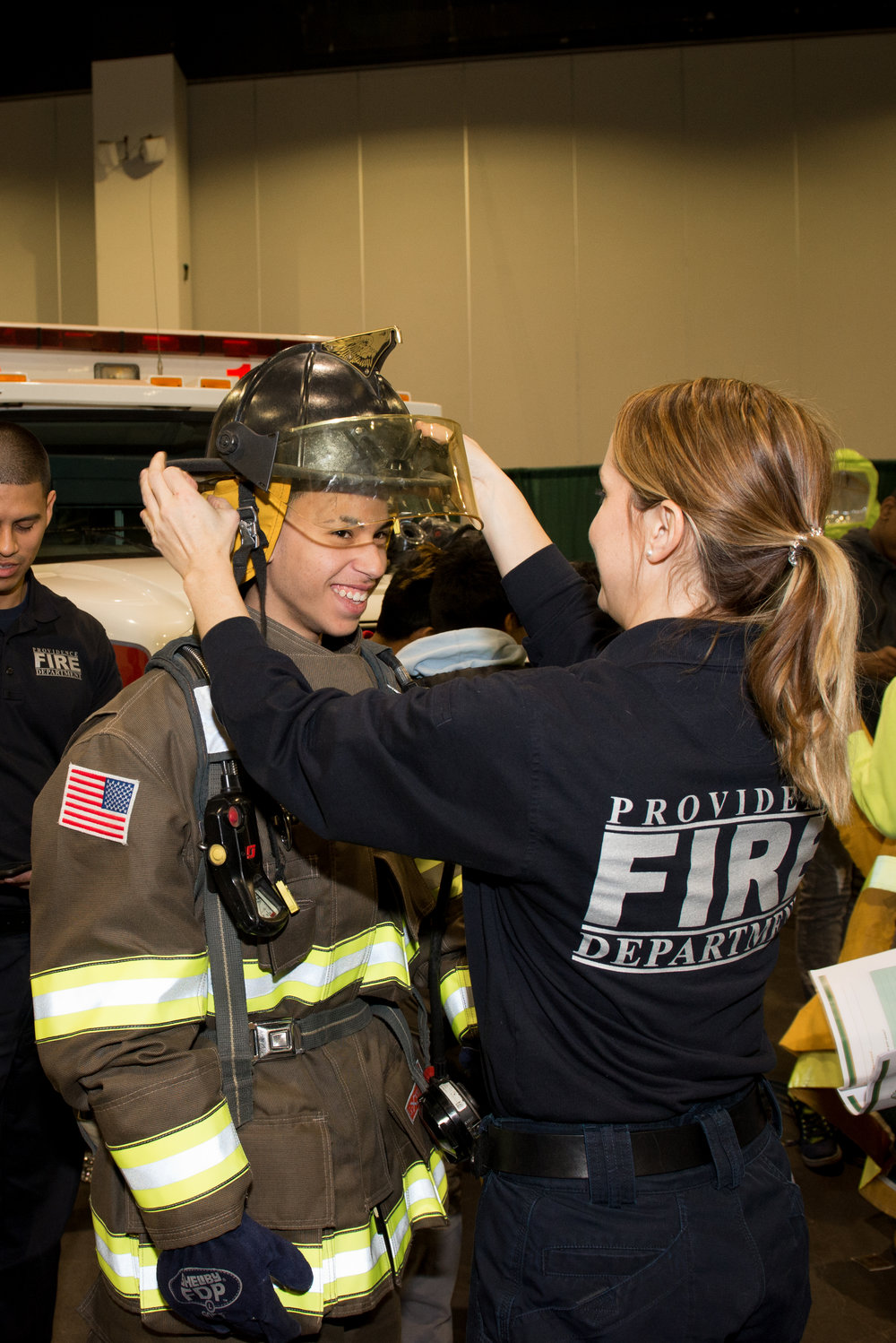 A student at the JA Inspire Career Exploration Fair with members of the Providence Fire Department learning about what it takes to become one of Providence's finest. In the banner photo above, students had the opportunity to work with the Plumbers, Pipefitters, and HVAC Local 51's virtual arc welder.