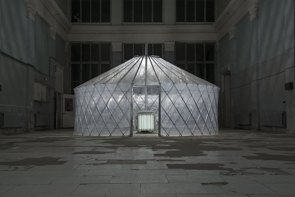 Mongolian yurt – a masterpiece of minimalism and utilitarian, modern spaces for living and working has almost approached to such standard – we are content with essential, but it seems, is too much of such essential stuff.   Nomadic structure, 2012.   Installation. Metal profile, lamps, electric wires, plastic wrap. 6x4m