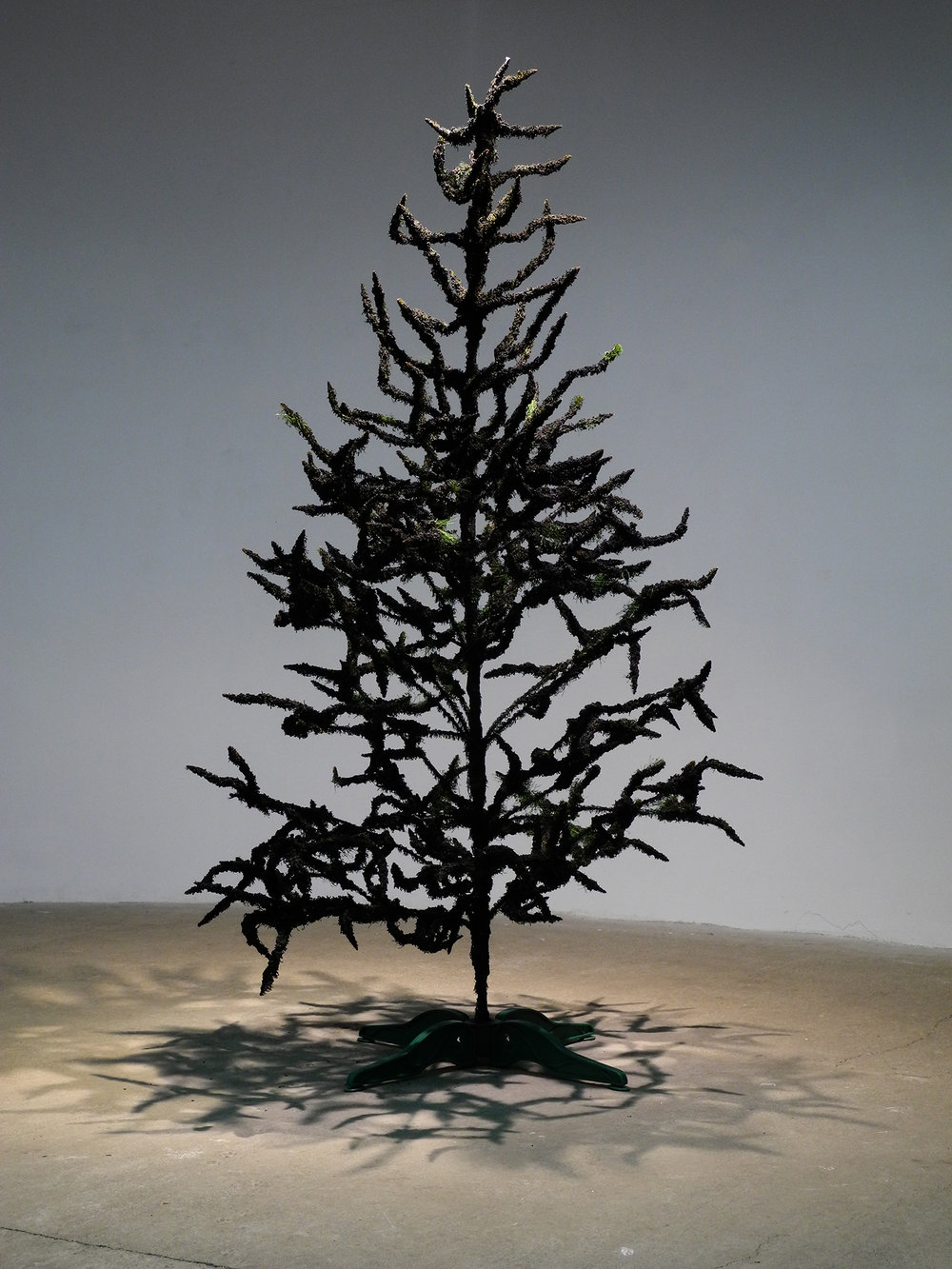Burned plastic tree smells like fire of street conflicts.   Burned   2015, object. Plastic christmas tree