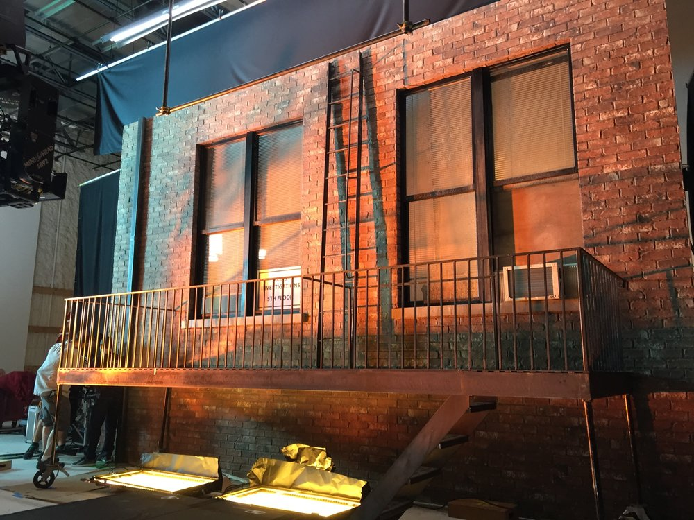 Build in progress at Steiner Studios in NYC. Welded steel fire escape, brick facade, etc. all custom for maximum control and coordinator with post.