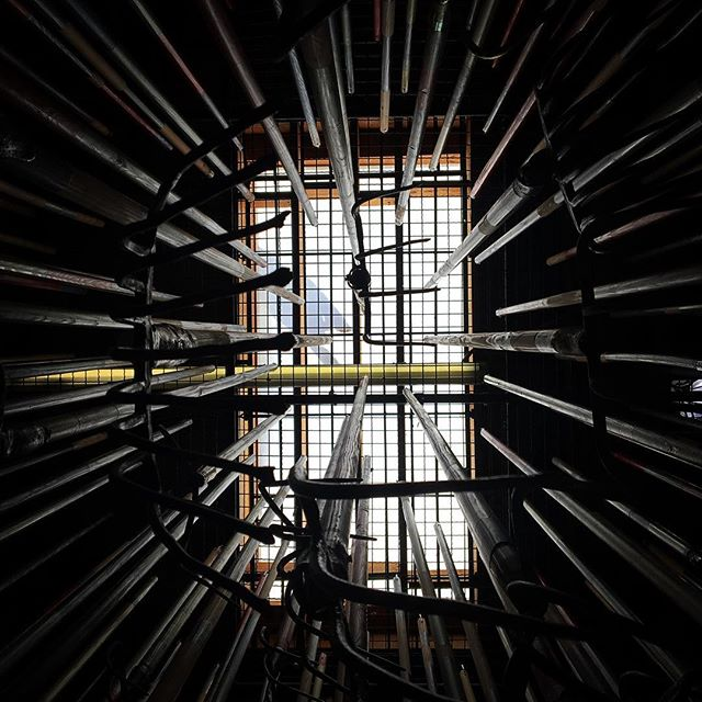 "Looking straight up at 300 pitchforks pointing directly at my face. ""The Crusher"" was one of the #14thFactory 's many art installations. It was an intense exhibit and this is an intense, powerful piece. #defiance #perspective #weaponry"