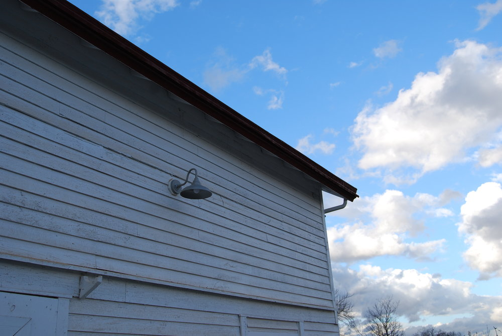 Exterior wall with clouds and light.JPG