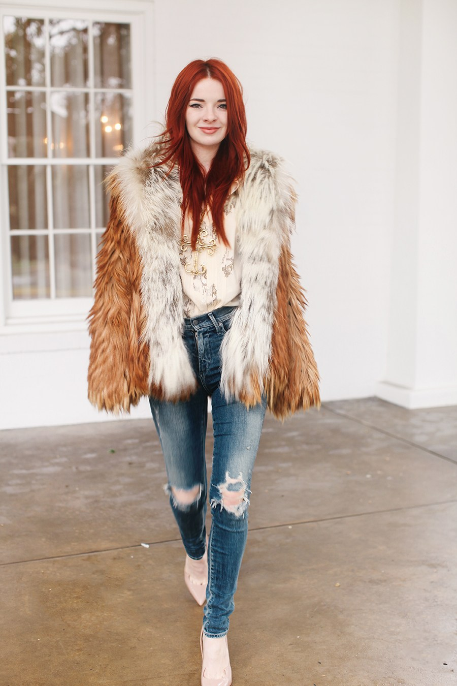 fur jacket ripped jeans.jpg