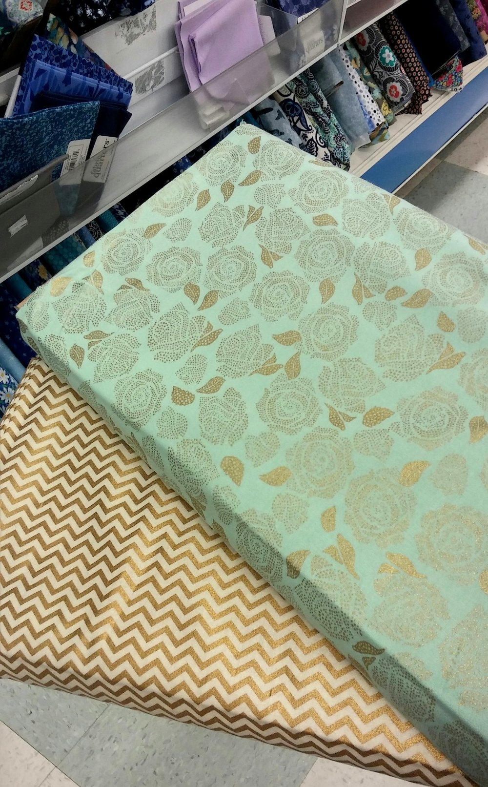 mint and gold rose fabric